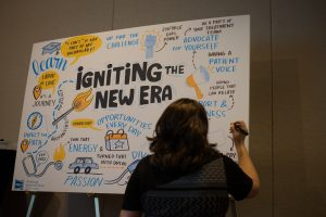 An artist from the Ink Factory captured speakers' comments in real time on large storyboards, which were then displayed around the Symposium's exhibit area.