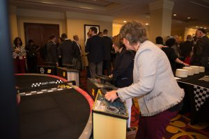 In addition to numerous networking and educational opportunities for the nearly 400 Symposum attendees, some folks had the chance to enjoy some of the day's race-themed events, including this electronic race car challenge. Here, employer-members Carrie Rust from Ellwood Group, Inc., and Lisa Harris, from the Eat'n Park Hospitality Group, Inc., compete.